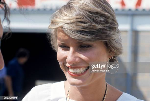 Suzy Hunt watches her husband James Hunt motor racing at Brands Hatch on July 18 1974 in Brands Hatch England The couple were married between 1974...