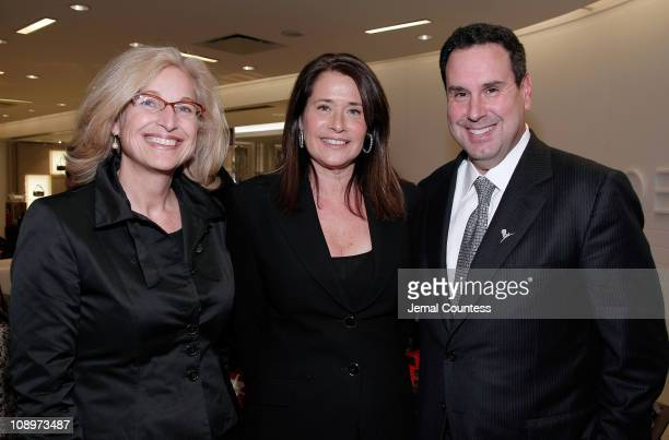 Suzy Johnson of SAKS Fifth Ave with Saks Ceo Steve Sadove and Actress Lorraine Bracco at the PreParty for the Saks Fifth Avenue Holiday Window...