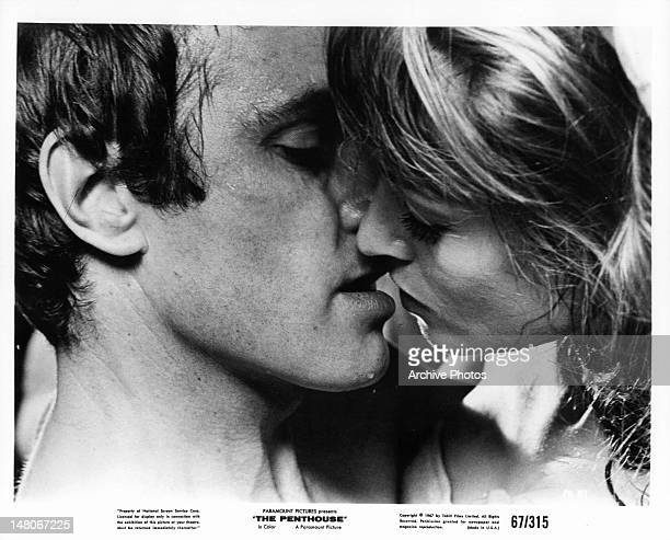 Suzy Kendall and man about to kiss in a scene from the film 'The Penthouse' 1967