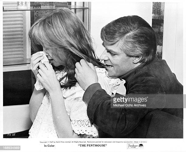 Suzy Kendall cries as Norman Rodway tries to comfort her in a scene from the film 'The Penthouse' 1967