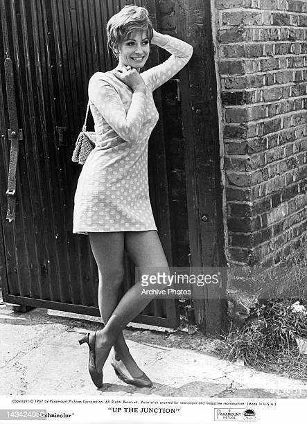 Suzy Kendall leaning up against gate in a scene from the film 'Up The Junction' 1967