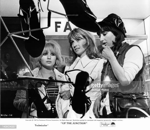 Suzy Kendall looking at shoes with other women in a scene from the film 'Up The Junction' 1967