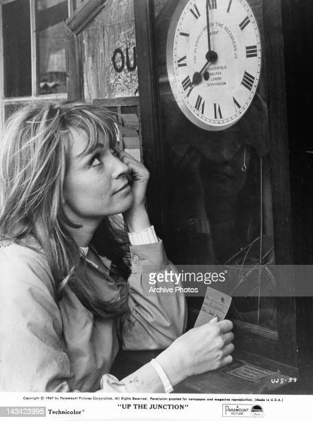 Suzy Kendall looking up at clock in a scene from the film 'Up The Junction' 1967