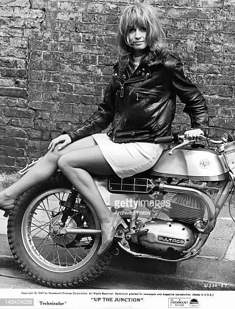 Suzy Kendall posing on motor bike in a scene from the film 'Up The Junction' 1967