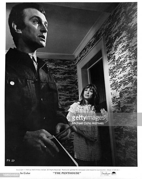 Suzy Kendall stands in the doorway looking at Tony Beckley in a scene from the film 'The Penthouse' 1967