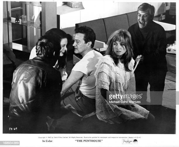 Suzy Kendall Terence Morgan and Norman Rodway in a scene from the film 'The Penthouse' 1967