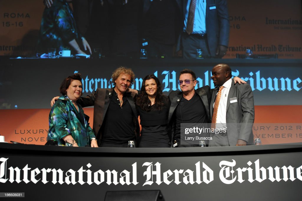 Suzy Menkes, International Herald Tribune Fashion Editor, Renzo Rosso, Diesel Founder, Alison Hewson, Bono and Erastus Kibugu of TechnoServe pose during the third day of the 2012 International Herald Tribune's Luxury Business Conference held at Rome Cavalieri on November 16, 2012 in Rome, Italy. The 12th annual IHT Luxury conference is the premier meeting point for the luxury industry. 500 delegates from 30 countries have gathered in Rome to hear from the world's most inspirational fashion designers and luxury business leaders.