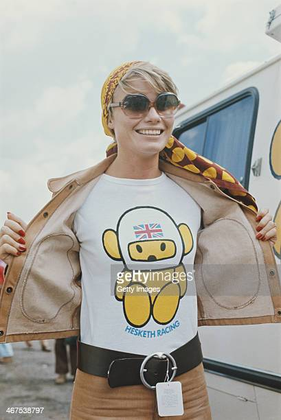 Suzy Miller wife of James Hunt driver of the Hesketh Racing Hesketh 308 Ford Cosworth DFV V8 shows her Hesketh Super Bear T shirt during the British...