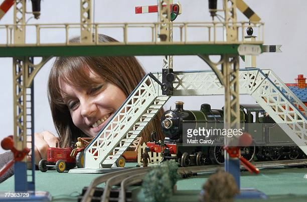 Suzy Wall from Chilcotts Auctioners and Valuers moves a toy tractor beside the Hornby Ogauge toy train the Folkestone Flyer valued at 10001500 GBP at...