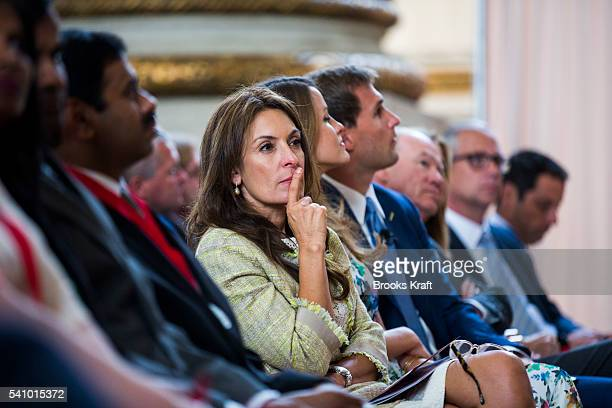 Suzy Welch listens to her husband former General Electric CEO Jack Welch speak at a ceremony June 11 2016 in Washington DC She is an author...