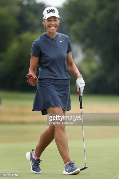 Suzy Whaley reacts to her putt on the ninth green during the first round of the US Senior Women's Open at Chicago Golf Club on July 12 2018 in...