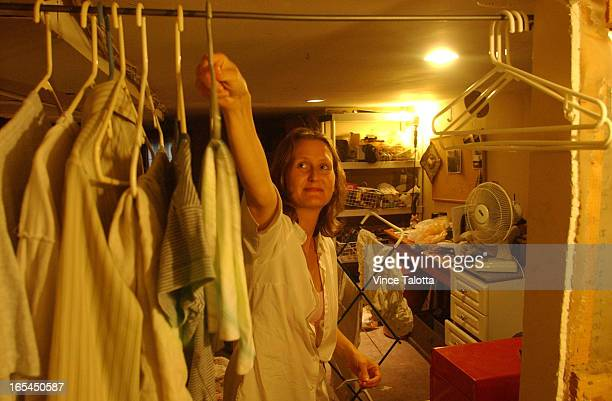 HOUSE 8/12/04 Suzzane Gossage hangs clothes to dry in basement to avoid using the dryerSuzanne Gossage and Patrick Chase have chosen to make their...