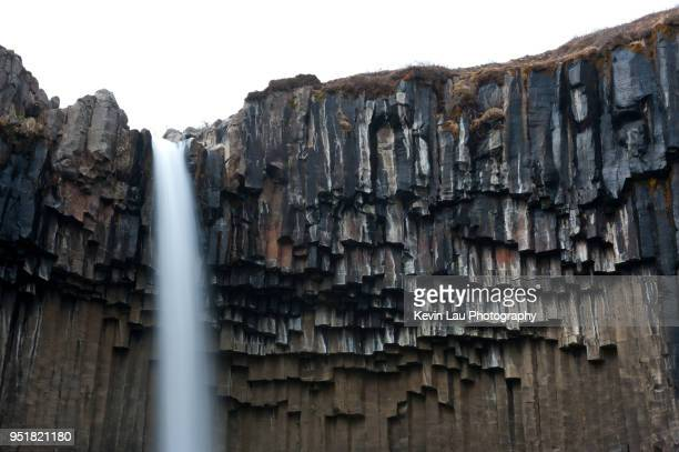 svartifoss in skaftafell in iceland - basalt stock pictures, royalty-free photos & images