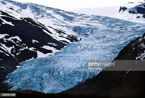 Svartisen Glacier, viewed from the Coastal Express which sails between Bergen and Kirkenes. For more than a century, the coastal steamer Hurtigruten...