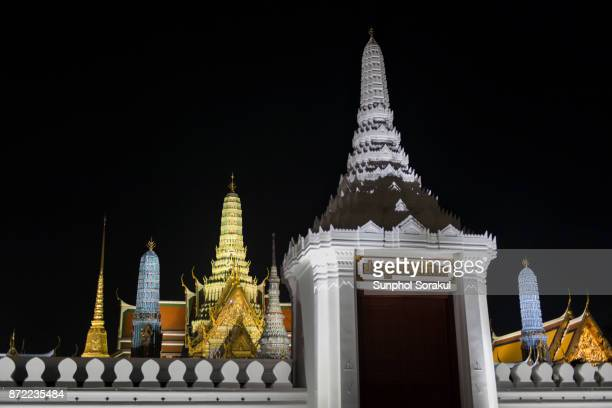Svasti Sopha Gate with the roof of Wat Phra kaew at night, Bangkok, Thailand