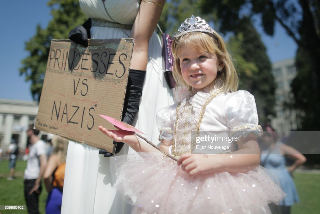 Svea Vikander and her fourpyear-old daugher are seen dressed as princesses at MLK Jr. Park on August 27, 2017 in Berkeley, California. The park became a center of left-wing protest when hundreds of people opposed to President Trump and hundreds more aligned with Antifa descended on it after a planned right-wing rally was cancelled.