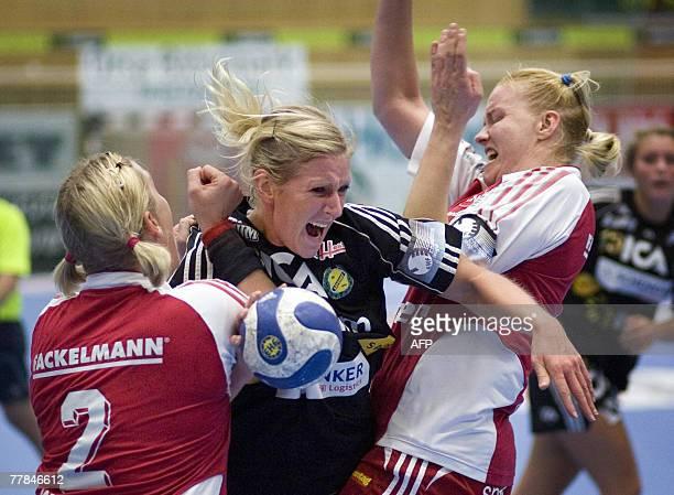 Svehof's Johanna Ahlm clashes with Nrnberg's defenders Maja Sommerlund and Miriam Simakovan in the Champions League handball match between Savehof...