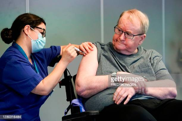 Svein Andersen, 67 years-old resident of 'Ellingsrud home' and first in Norway to receive the vaccine is given the Pfizer-Biontech Covid-19 corona...