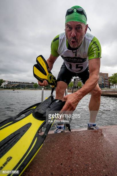 Svein Hobbesland coming out of the water at the TriQuart SwimRun event on July 29 2017 in Kristiansand Norway The athletes are allowed to use...