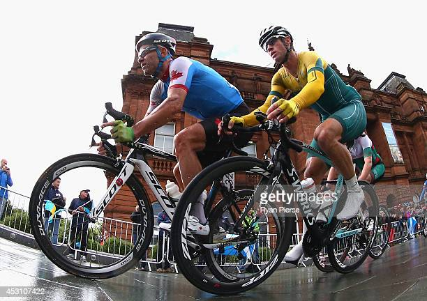 Svein Tuft of Canada and Mark Renshaw of Australia compete during the Men's Cycling Road Race during day eleven of the Glasgow 2014 Commonwealth...