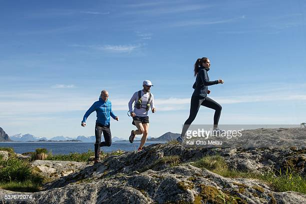 Svein Vestoel Frode Lein and Ane Ottemo Gartner testing parts of the trail The Arctic Triple Lofoten Ultra on June 2 2016 in Svolvaer Norway