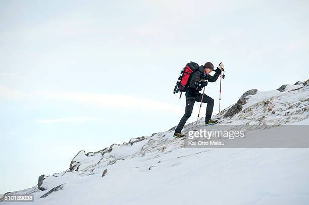 Svein Vestoel making his way up the mountain pass on February 13 2016 in Svolvar Norway The water temperature is around 4c and after the swimleg the...