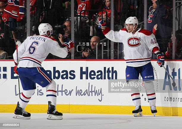 Sven Andrighetto of the Montreal Canadiens celebrates his goal at 1417 of the second period against the New Jersey Devils and is joined by Greg...