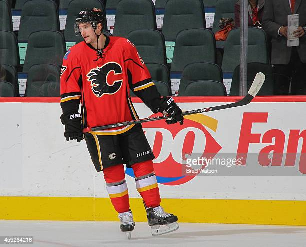 Sven Baertchi of the Calgary Flames skates in warm-up before the game against the Arizona Coyotes at Scotiabank Saddledome on November 13, 2014 in...