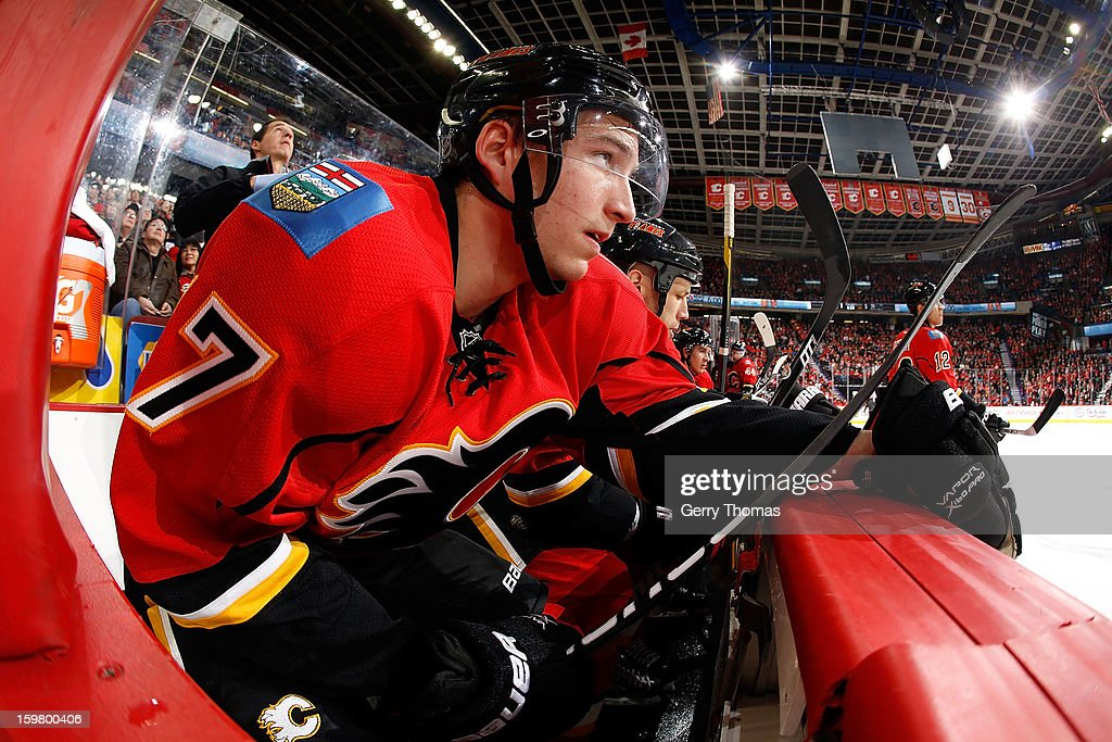 Sven Baertschi #47 of the Calgary Flames sits on the bench in between shifts against the San Jose Sharks on January 20, 2013 at the Scotiabank Saddledome in Calgary, Alberta, Canada.