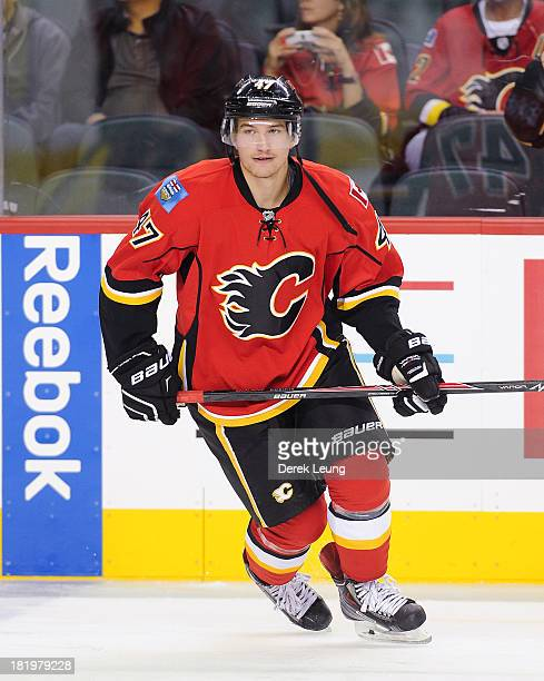 Sven Baertschi of the Calgary Flames skates against the Phoenix Coyotes during a preseason NHL game at Scotiabank Saddledome on September 25 2013 in...