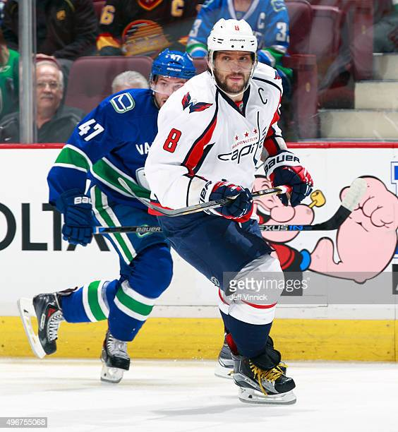 Sven Baertschi of the Vancouver Canucks and Alex Ovechkin of the Washington Capitals skate up ice during their NHL game at Rogers Arena October 22,...