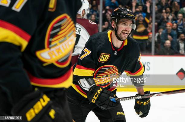 Sven Baertschi of the Vancouver Canucks celebrates a goal by teammate Adam Gaudette against the Colorado Avalanche during the first period at Rogers...