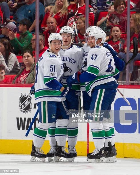 Sven Baertschi of the Vancouver Canucks celebrates his first period goal with teammates Troy Stecher Bo Horvat and Brock Boeser during an NHL game...