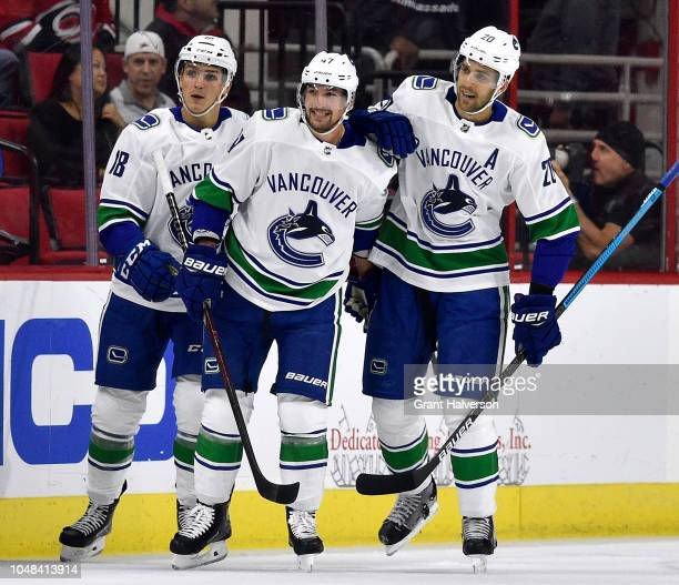 Sven Baertschi of the Vancouver Canucks celebrates with teammates after scoring a firstperiod goal against the Carolina Hurricanes during their game...