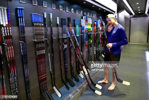 Sven Baertschi of the Vancouver Canucks checks his sticks before their NHL game against the New Jersey Devils at Rogers Arena November 10, 2019 in...