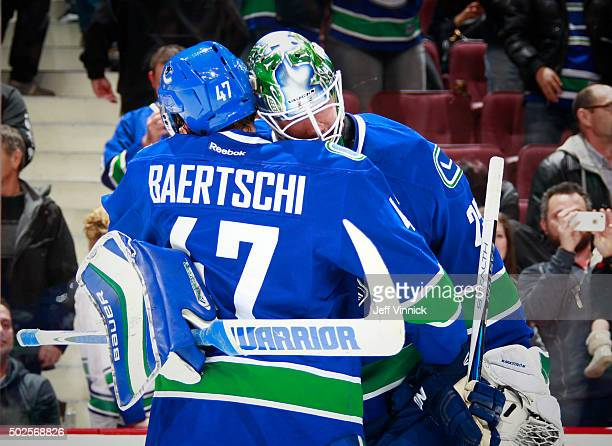Sven Baertschi of the Vancouver Canucks congratulates Jacob Markstrom after their victory over the Edmonton Oilers in their NHL game at Rogers Arena...