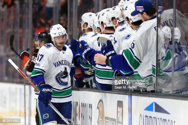 Sven Baertschi of the Vancouver Canucks is congratulated at the bench after scoring a goal during the first period of a game against the Anaheim...