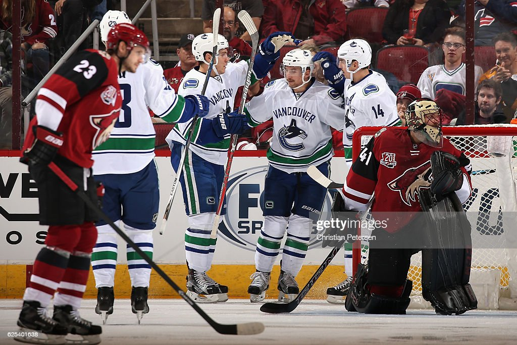 Sven Baertschi #47 (C) of the Vancouver Canucks is congratulated by Bo Horvat #53 and Alexandre Burrows #14 after scoring a goal against the Arizona Coyotes during the first period of the NHL game at Gila River Arena on November 23, 2016 in Glendale, Arizona.