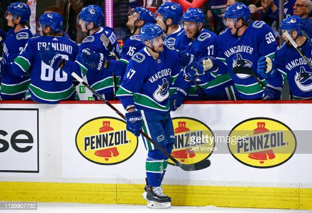 Sven Baertschi of the Vancouver Canucks is congratulated by teammates after scoring during their NHL game against the Dallas Stars at Rogers Arena...
