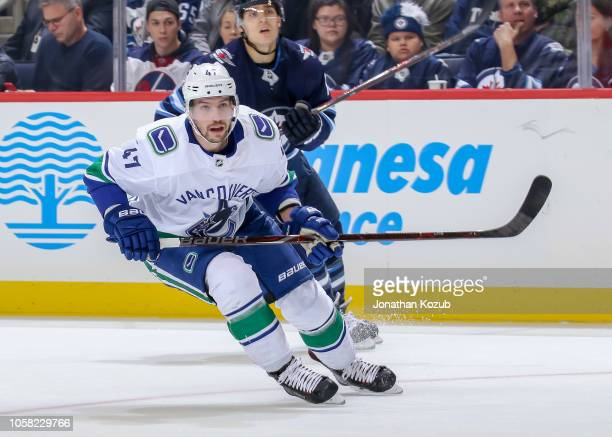 Sven Baertschi of the Vancouver Canucks keeps an eye on the play during second period action against the Winnipeg Jets at the Bell MTS Place on...