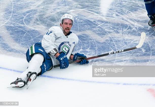 Sven Baertschi of the Vancouver Canucks lays on the ice while cooling down after a conditioning skate at the end of practice on the first day of the...