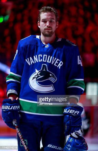 Sven Baertschi of the Vancouver Canucks listens to the national anthem during their NHL game against the Dallas Stars at Rogers Arena March 30, 2019...