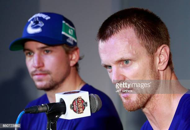 Sven Baertschi of the Vancouver Canucks looks as as teammate Henrik Sedin answers questions during a press conference after the preseason game...