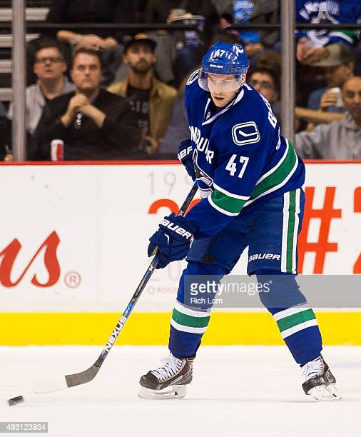 Sven Baertschi of the Vancouver Canucks passes the puck in NHL action against the Calgary Flames on October 10 2015 at Rogers Arena in Vancouver...
