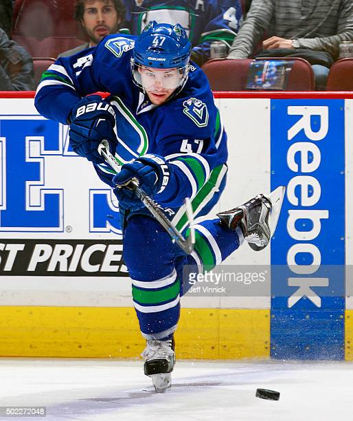 Sven Baertschi of the Vancouver Canucks passes the puck up ice during their NHL game against the Buffalo Sabres at Rogers Arena December 7 2015 in...