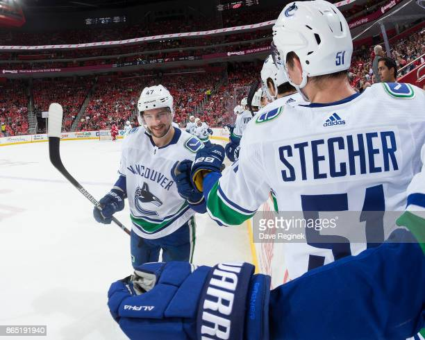 Sven Baertschi of the Vancouver Canucks pounds gloves with teammate Troy Stecher on the bench following his second period goal during an NHL game...