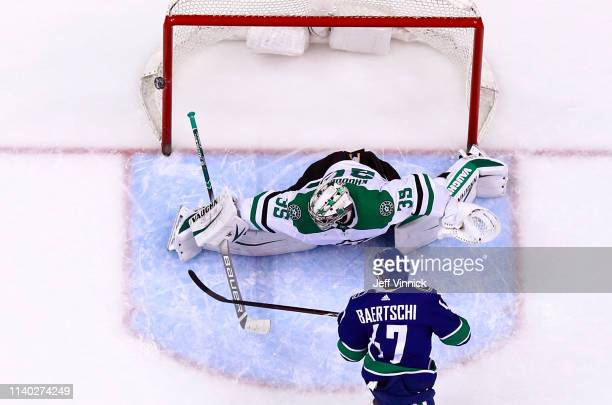 Sven Baertschi of the Vancouver Canucks shoots on Anton Khudobin of the Dallas Stars in the shootout during their NHL game at Rogers Arena March 30,...