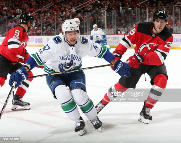 Sven Baertschi of the Vancouver Canucks skates against Damon Severson of the New Jersey Devils during the first period on November 24 2017 at the...
