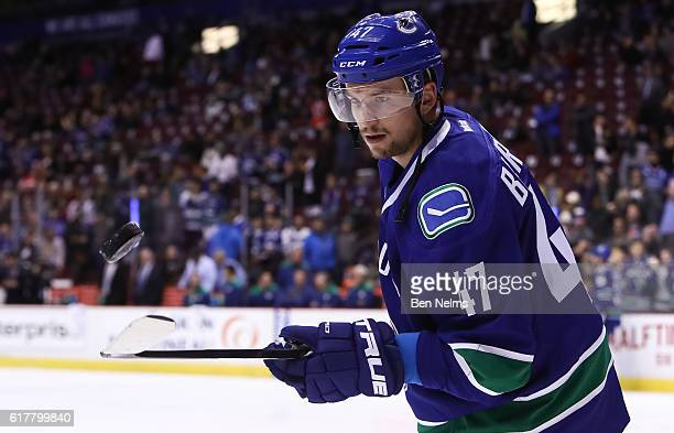 Sven Baertschi of the Vancouver Canucks skates during warmup prior to facing the Calgary Flames before their NHL game at Rogers Arena on October 15...