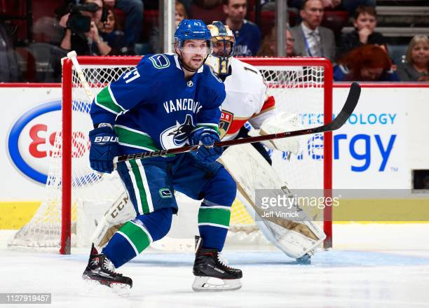 Sven Baertschi of the Vancouver Canucks skates past Roberto Luongo of the Florida Panthers during their NHL game at Rogers Arena January 13, 2019 in...
